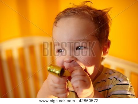 Portrait of the boy playing in playpen.