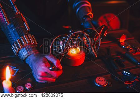 Steampunk Cosplay. Hands Of A Man An Engineer Inventor Repairing A Fantastic Post-apocalypse Glasses