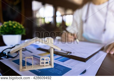 The Customer Is Signing The House Purchase Contract With House Model, Price Of House Paper, Contract