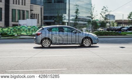 Opel Astra J Fast Speed Driving On The Asphalt Road. Moscow, Russia - August 2021