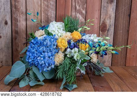 Beautiful Bouquet Of Arranged Blue Hydrongea And Yellow Rose Flowers, Given As An Emotional Sentimen