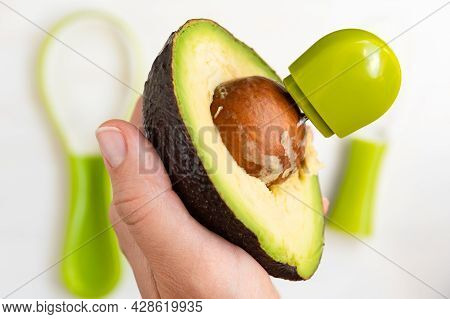 Remove The Seeds From The Avocado. Cut Avocado. Special Knife For Cutting And Slicing Avocado. Ripe,