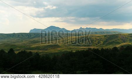 Incredibly Beautiful Summer Landscape Overlooking The Lush Green Hills. Shot. Aerial View Of Mountai