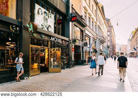 Helsinki, Finland - July 28, 2014: View Of Kluuvikatu Street. People Walk Down Street On A Summer Ev