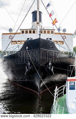 Stockholm, Sweden - July 20, 2021: Front Bow View Of The Old Vintage Steamship Sankt Erik Moored In