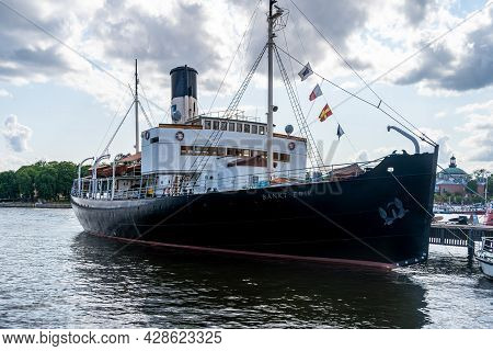 Stockholm, Sweden - July 20, 2021: Front Side View Of The Old Vintage Steamship Sankt Erik Moored In