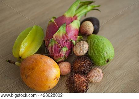 Group Of Fresh Tropical Fruits, Passion Fruit, Carambola, Dragon Fruit Or Pitaya, Mangosteen, Lichi,