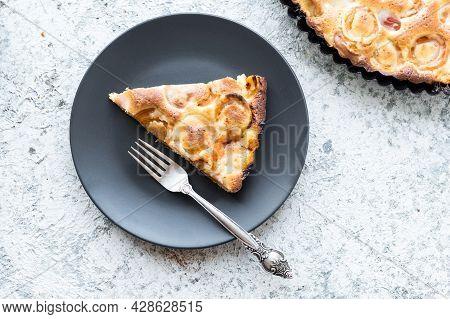 Slice Of Fresh Baked Apricot Cake. Homemade Apricot Tart On Grey Concrete Background. Fresh Baked Ro