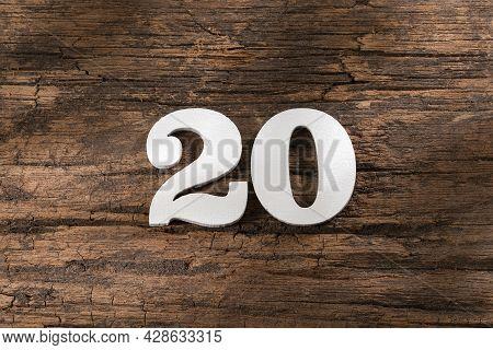 Number Twenty 20 - White Piece On Rustic Wood Background