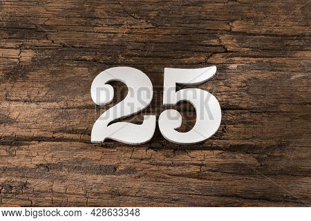 Twenty Five 25 - White Wooden Number On Rustic Background
