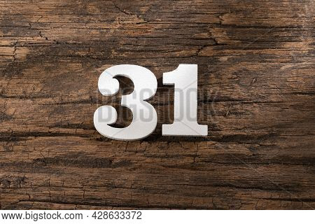 Thirty One 31 - White Wooden Number On Rustic Background