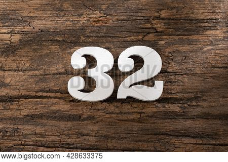 Number Thirty Two 32 - White Piece On Rustic Wood Background