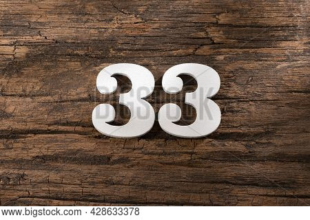 Thirty Three 33 - White Wooden Number On Rustic Background