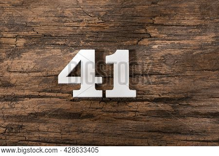 Forty One 41 - White Wooden Number On Rustic Background