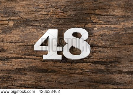 Number Forty Eight 48 - White Piece On Rustic Wood Background
