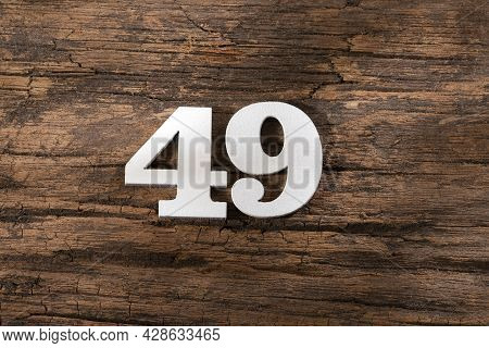 Forty Nine 49 - White Wooden Number On Rustic Background