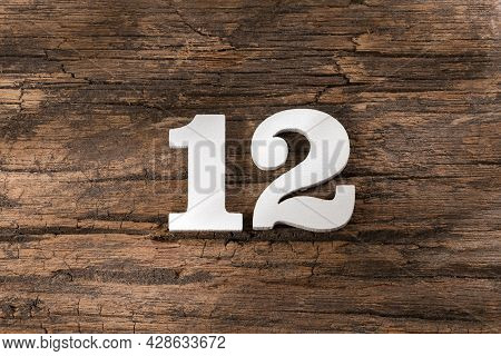Twelve 12 - White Wooden Number On Rustic Background