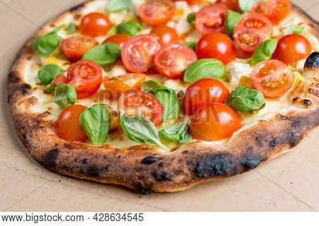Tasty Pizza On A The Table. Cheese Pizza. Pepperoni Pizza. Mushroom Pizza. Mozzarella And Tomato. It