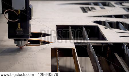 Robotic Machine With Laser For Metal Cutting. Hdr. Close-up Of Industrial Laser Cuts Patterns On Met
