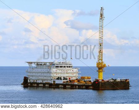 A Typical Offshore Accommodation And Work Barge In The Oil And Gas Industry. Offshore Accommodation