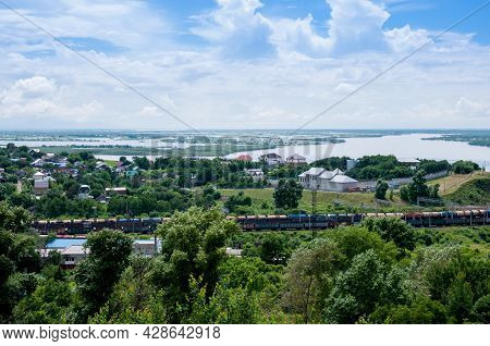 Summer Russian Landscape, Cottages On The Banks Of The Amur River And A Passing Train