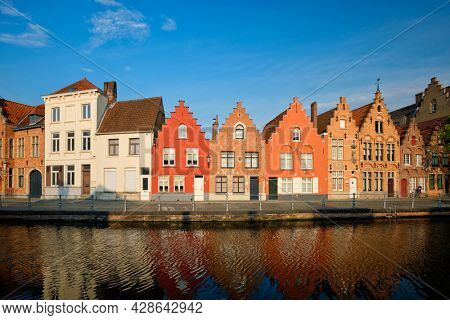 Typical Belgian cityscape Europe tourism concept - canal and old houses on sunset. Bruges (Brugge), Belgium