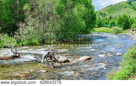 View Of The Purest, Useful, Transparent Mountain River In A Rocky High Altitude Area Against The Bac