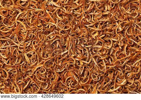 Preserved dried bitter orange peel close up full frame