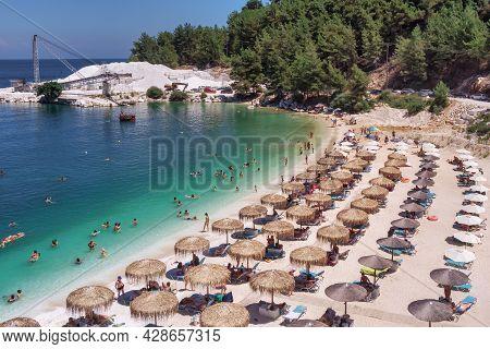 Porto Vathy, Marble Beach, Thassos, Greece- July 19, 2021: Aerial View Of The Porto Vathy Beach Of A