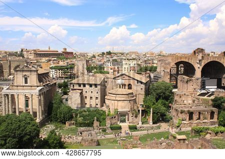 Aerial view on Roman forum - the center in ancient Rome. Temple of Vespasian and Titus, temple of Saturn and triumphal arch of Septimius Severus. Rome, Italy, Europe