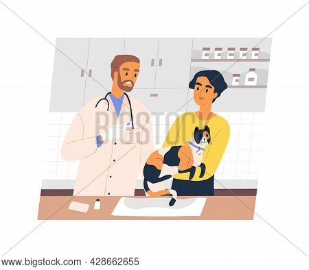 Pet Owner Holding Cat In Hands For Vaccination In Vet Clinic. Animal And Smiling Veterinarian With S