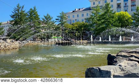 City Summer Landscape With Fountain. Public Park In Perm, Russia. Jets Of Water