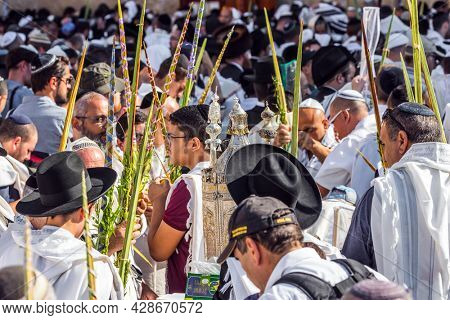 JERUSALEM, ISRAEL - SEPTEMBER 26, 2018: Touching ceremony at the Western slope. Jews praying at the Western Wall wrapped in festive white Talit. The blessing of the Cohanim. The concept of pilgrimage