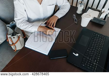 Woman Hand Writing In Notebook, Top View.