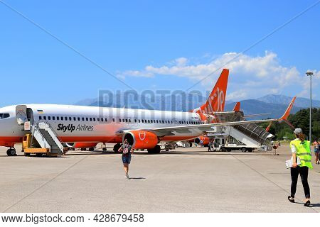 The Plane Of Ukrainian Low-cost Airline Sky Up Is On The Runway At Tivat International Airport. The