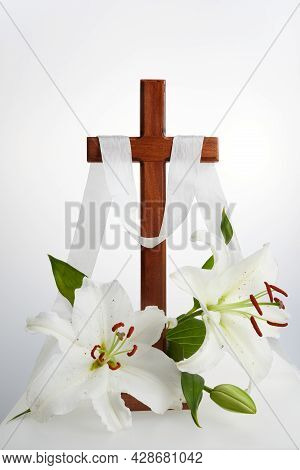 Cross With Lilies On White Background. Spring Background. Easter, Baptism Or First Communion Concept