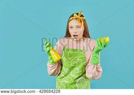 Ready For Spring-cleaning. Portrait Of Joyful Girl With Household Supplies In Hands Over Blue Backgr