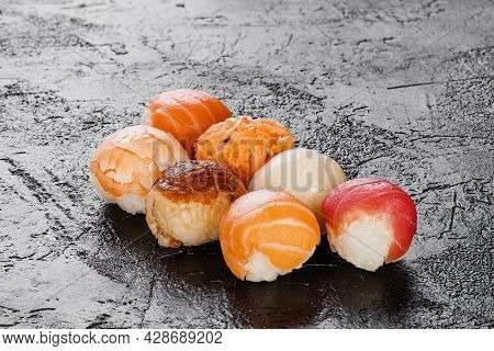 Set Of Traditional Sushi With Salmon, Tuna, Eel And Butterfish Isolated On Black Background. Layout.