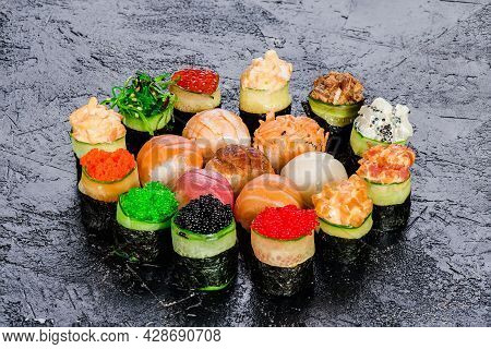 Set Of Gunkans Sushi And Traditional Sushi With Salmon, Tuna, Eel And Butterfish Isolated On Black B
