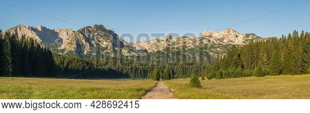 Big panorma of Durmitor mountains in Zabljak, Montenegro. Sunny summer morning in Durmitor National Park. Montenegro countryside with beautiful mountains range near the Zabljak town