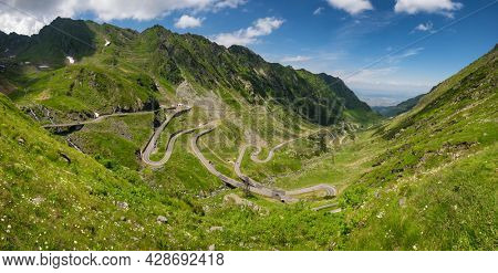 Big panorama of Transfagarasan road in summer. Located in Carpathian Mountains in Romania, Transfagarasan road is one of the most impressive mountain roads in the world.