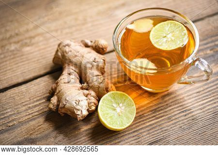 Ginger And Lemon Fresh Cocktail, Hot Ginger Juice In Glass And Slices Ginger Root Herbal Juice Tea