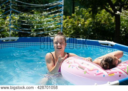 We Stay Chill. Happy Girls Have Fun In Outdoor Pool. Chill Pool Day. Poolside Play. Summer Vacation