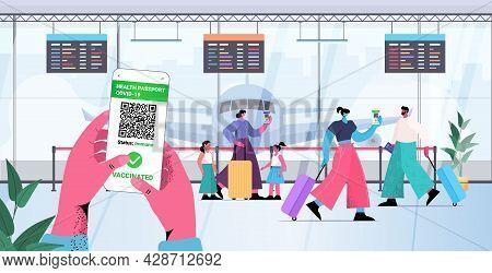 Travelers Using Digital Immunity Passports On Smartphone Screens Risk Free Covid-19 Pcr Certificate