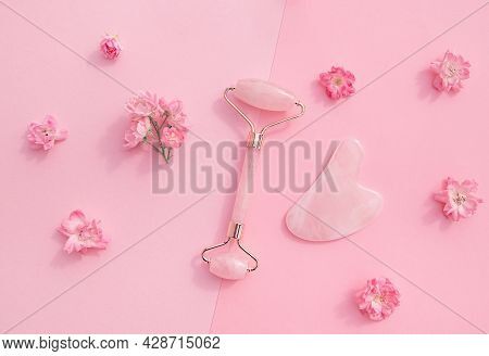 Facial Massage Kit For Home Spa. Face Roller  And Gua Sha Massager Made From Rose Quartz  On Pink Pa