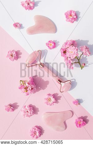 Facial Massage Kit For Home Spa. Face Roller  And Gua Sha Massager Made From Rose Quartz On White An