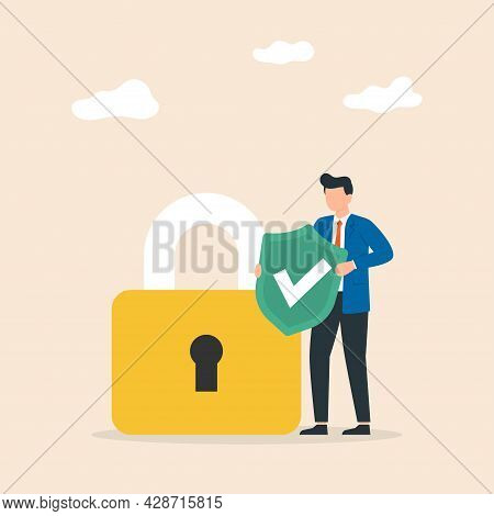 Cyber Security. Man Hold Shield With Padlock. Protection Of Computer Services And Electronic Informa
