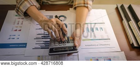 Top View. Entrepreneur Or Business Woman Holding Calculator And Press Button Of Calculator To Calcul