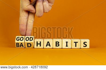 Good Or Bad Habits Symbol. Businessman Turns Wooden Cubes And Changes Words 'bad Habits' To 'good Ha