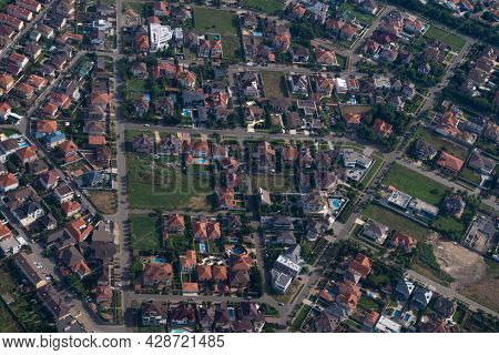 Residential Area, Rooftops, View From A Drone. Cottages In The Village. Land View Through The Airpla